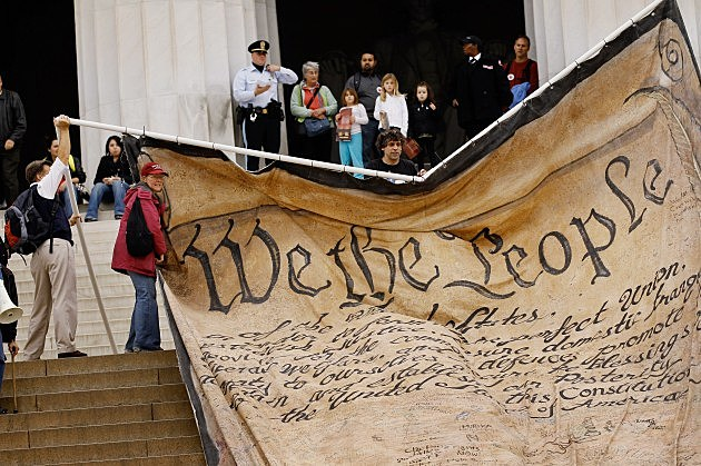 Larger than life mockup of U.S. Constitution displayed by activists protesting Supreme Court decision on corporate political spending