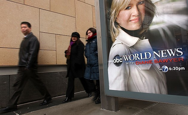 People walk by ABC advertising poster Februrary 2010... after the news division's announced cut of up to 400 staffers...