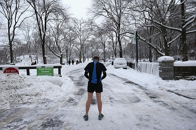 """A jogger prepares to run in Central Park, New York against official advisories during a snow storm that some have named """"Snowmageddon"""""""
