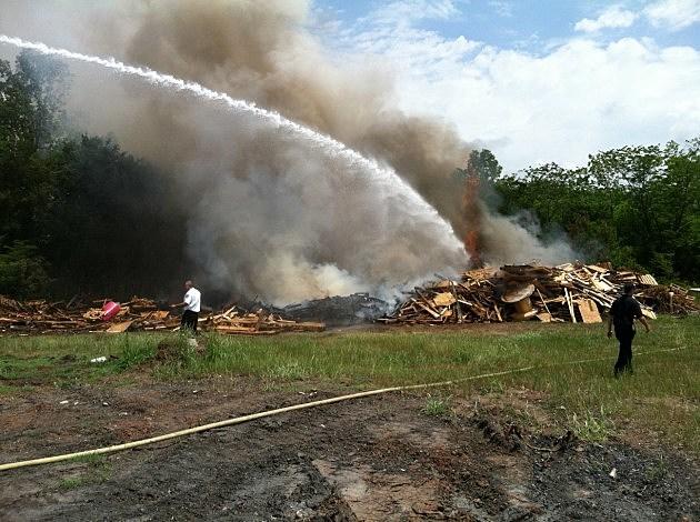 photo of burning Bossier City debris pile