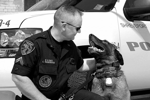 photo of Shreveport Police Corporal Christopher Yarborough and K-9 Mico
