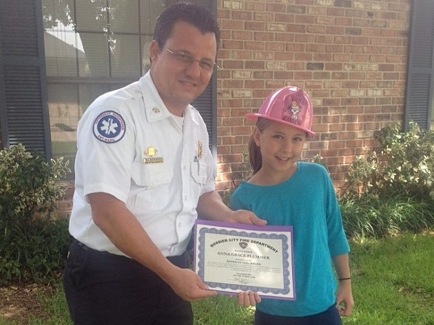 photo of BCFD Chief of Fire Prevention Jerry Nuckolls and Anna Grace Plummer