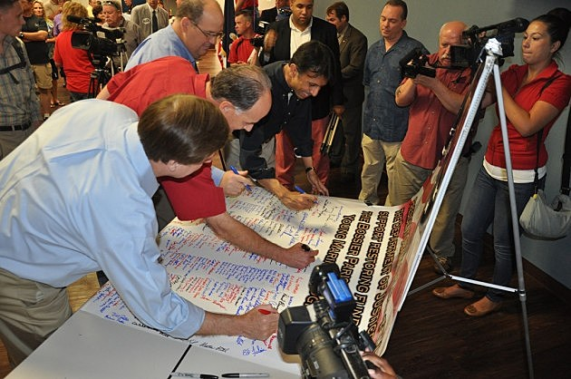 photo of banner signing