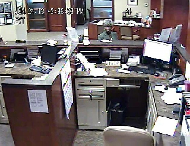 bank surveillance photo of woman