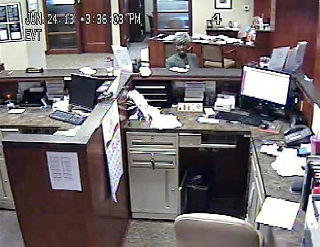 bank surveillance photo of woman