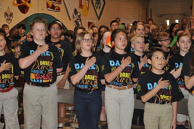 D.A.R.E. students recite the Pledge of Allegiance