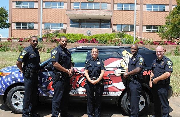 photo of D.A.R.E. instructors and SPD's ne D.A.R.E. vehicle