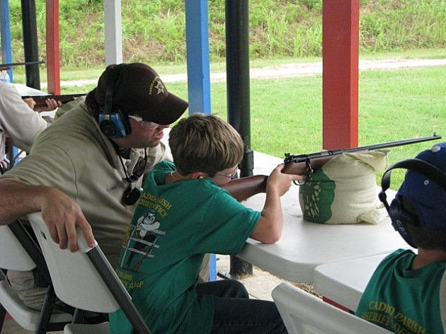 photo of youngster shooting .22 at Caddo Sheriff's Gun Safety Camp