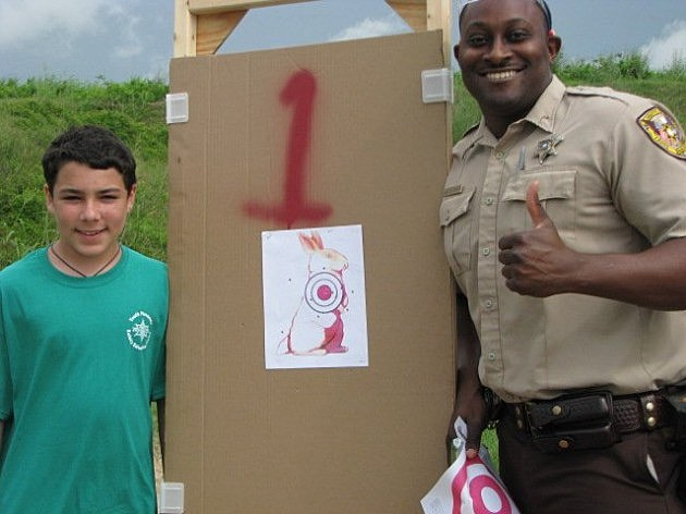 photo of happy shooter and instructor at Caddo Sheriff's Gun Safety Camp