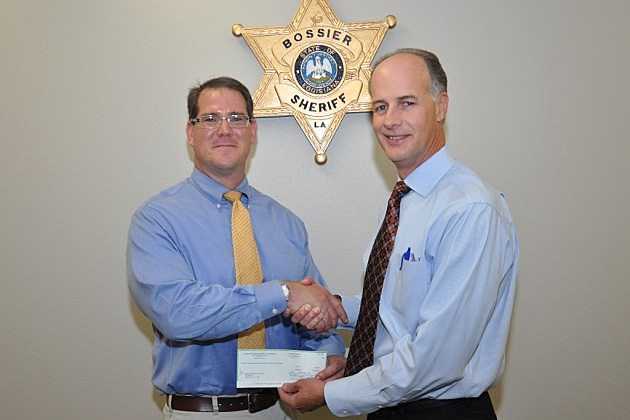 photo of Assistant DA Charles Jacobs presenting check to Sheriff Julian Whittington