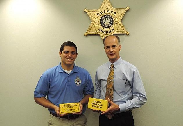 photo of Anthony Visciotti and Julian Whittington comparing yellow bricks