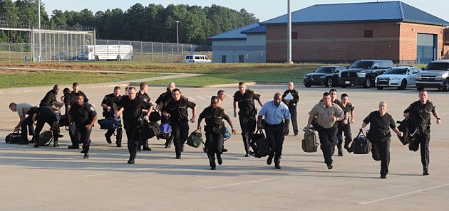 photo of NLCJA recruits running to building after being dismissed