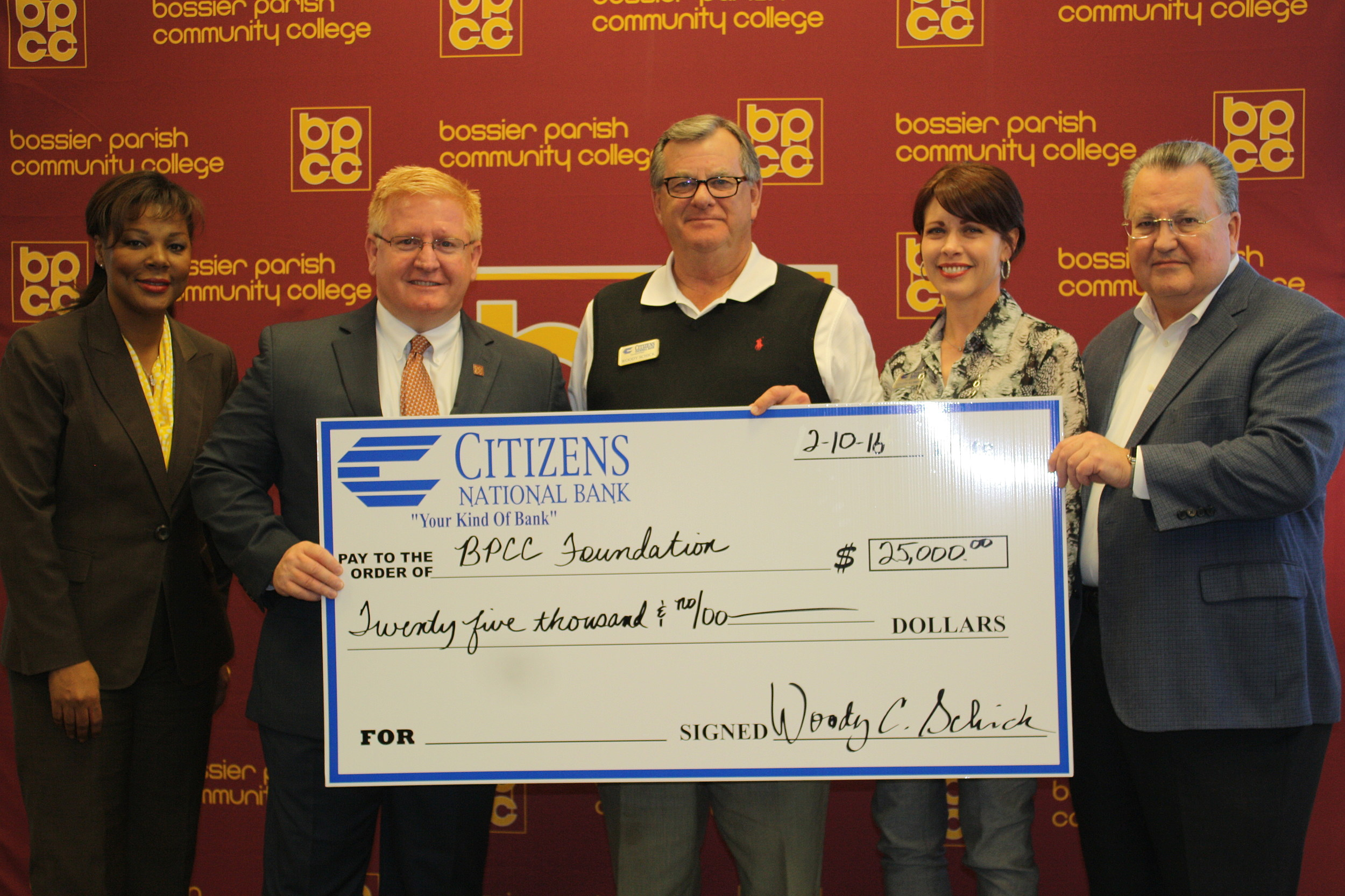 Photo Credit - BPCC <em>BPCC Chancellor Dr. Rick Bateman, Jr. (second from left) receives a donation from Citizens National Bank President/CEO Woody Schick and Bank Marketing & Sales Officer Cindy Aubrey (third & fourth from left).  Also pictured: Stephanie Rogers, BPCC Foundation Director, and Bruce Roberts, BPCC Foundation Board President.  Photo Credit - BPCC