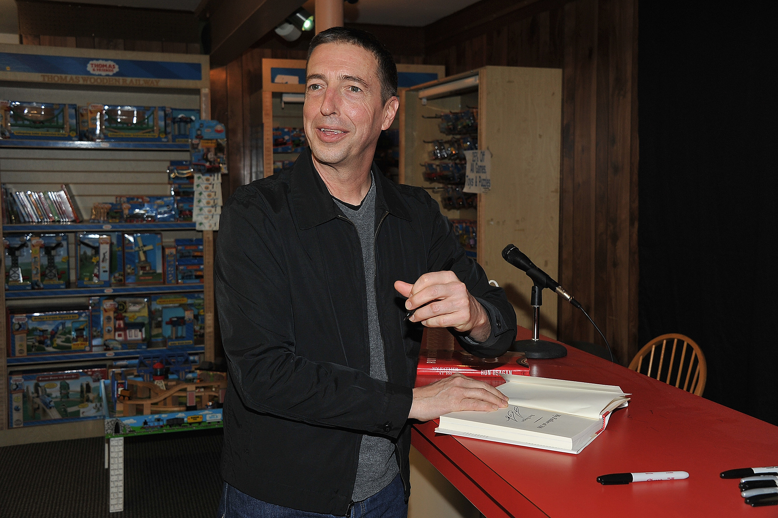 "Ron Reagan Signs Copies Of ""My Father At 100"""